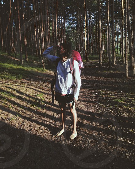 Guy walking in a forest photo