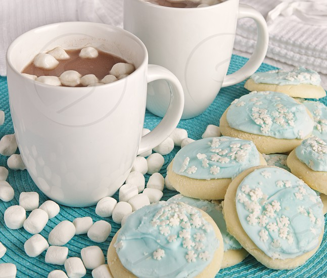 Hot chocolate with marshmallows and holiday cookies photo