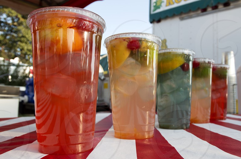 Brightly colored citrus drinks at fair or festival photo
