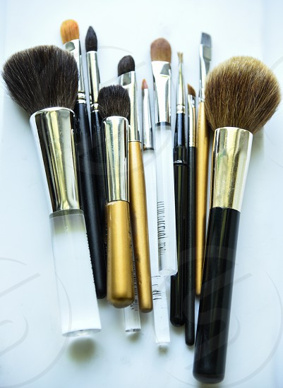 Beauty tools: powder brush concealer brush contour brush blending brush eye shadow brush lip liner brush highlighter brush eyebrow brush eyeliner brush bronzer brush photo