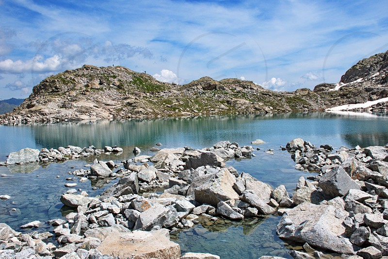 Scenic view of glacial lake in Brenta Dolomites with beautiful reflection of the rocks photo