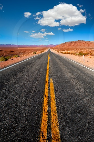 Never ending road to Death Valley California sunny desert photo