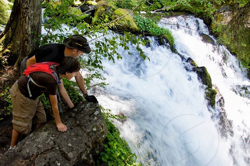 Top waterfall father son boy look forest Oregon photo