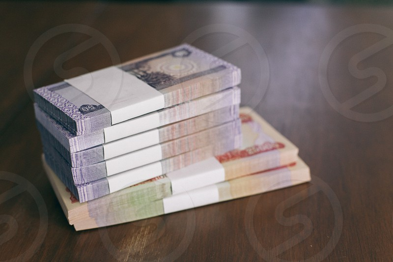 grey banknotes in bundle on table photo
