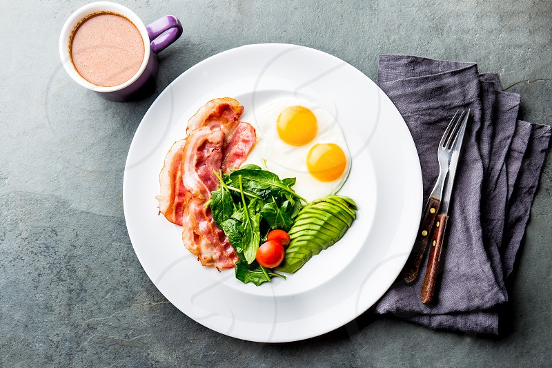 Ketogenic diet breakfast. fried egg bacon and avocado spinach and bulletproof coffee. Low carb high fat breakfast. photo