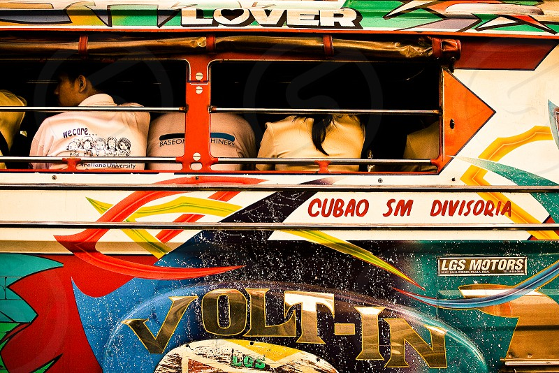 People Riding In A Jeepney photo