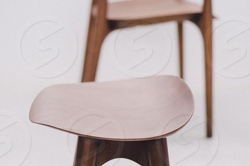 brown wooden stool near brown wooden armchair photo