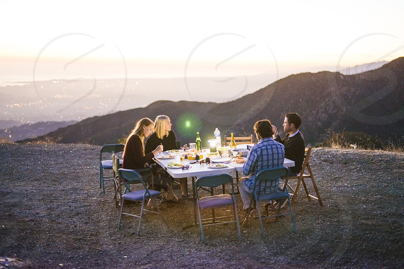 sunset dinner party in mountains at twilight photo