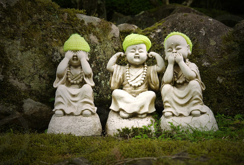 Statue of cheerful Buddhas. Statues in the Japanese garden. Tranquil corner in the garden photo