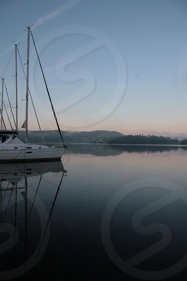 Calm water lake yachts boats water morning photo