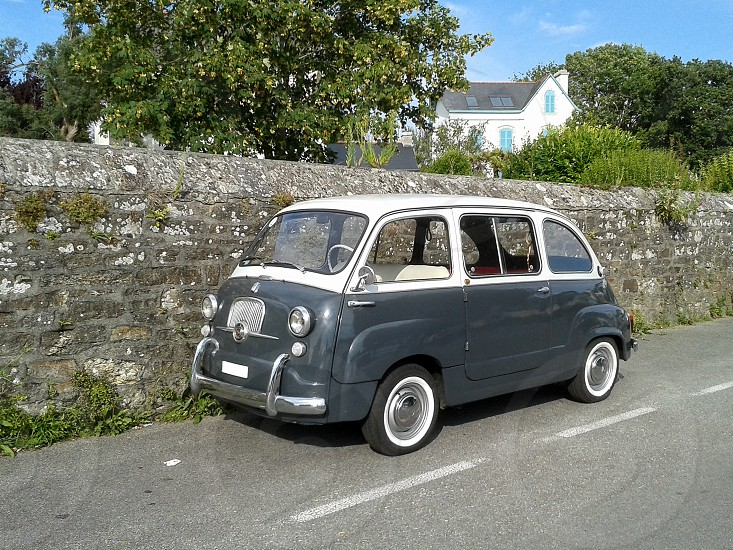 An old Italian car seen in France I think it's a Fiat 600 multipla. photo