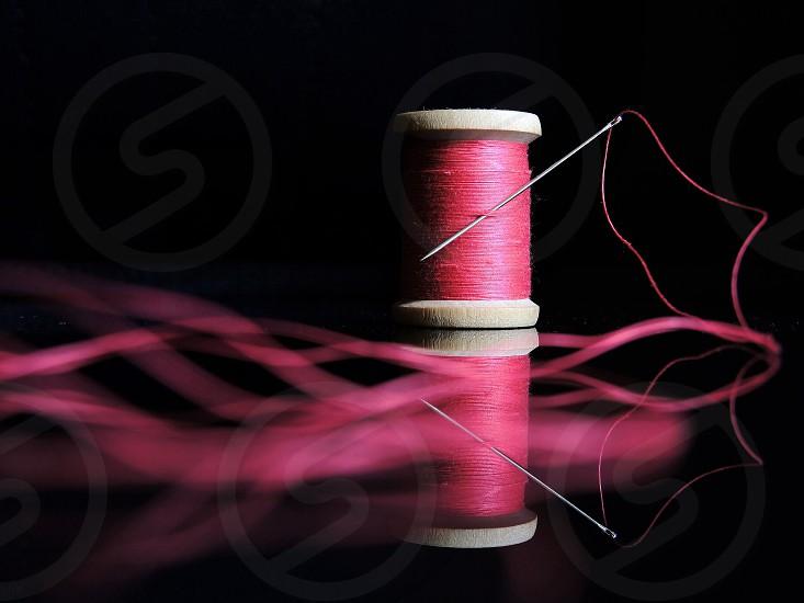 needle on the thread photo