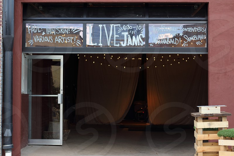 live jams sign over building photo