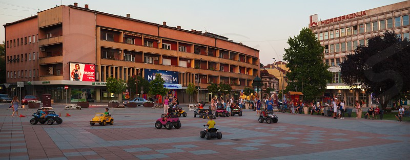 Cacak Serbia - August 09 2018: Center of the town during summer sidewalks and buildings details.  photo