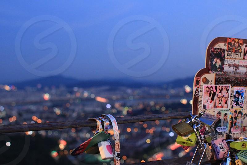 Love locks overlooking the city on N Seoul Tower Seoul South Korea photo