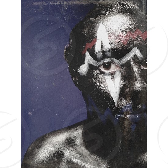 man in black tribal paint photo