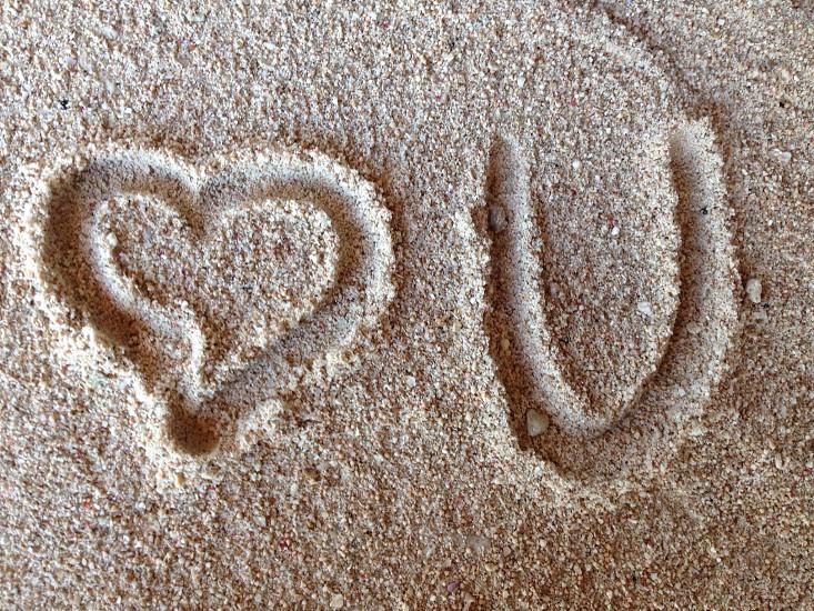 heart u print on grey sand photo