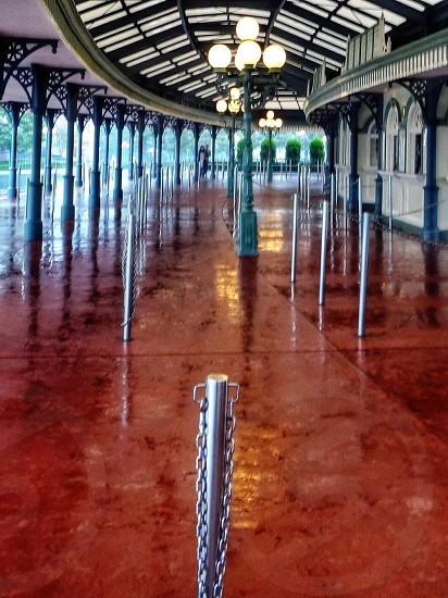 Empty ticket booth area on a rainy day. photo