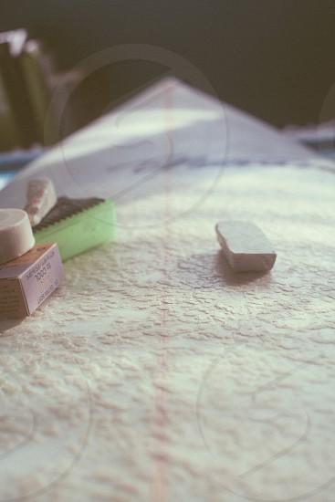 white rectangular rubber eraser on white textile photo