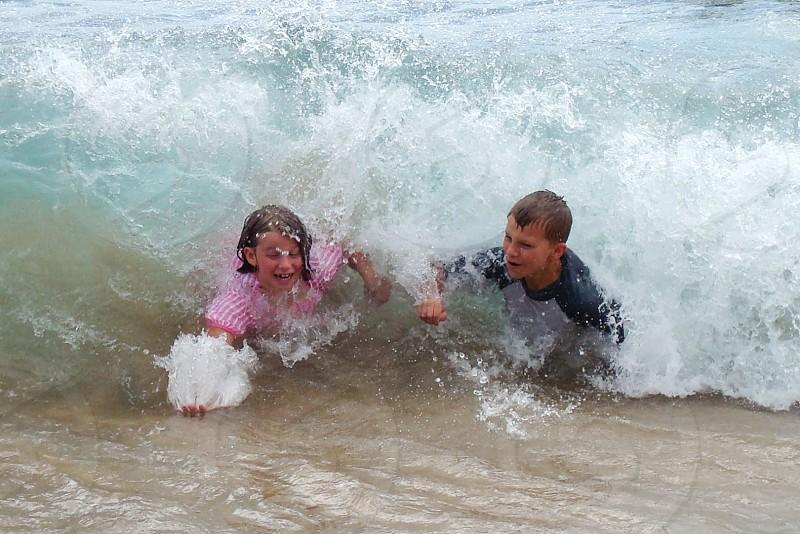 Body surfing waves Hawaii beach kids photo