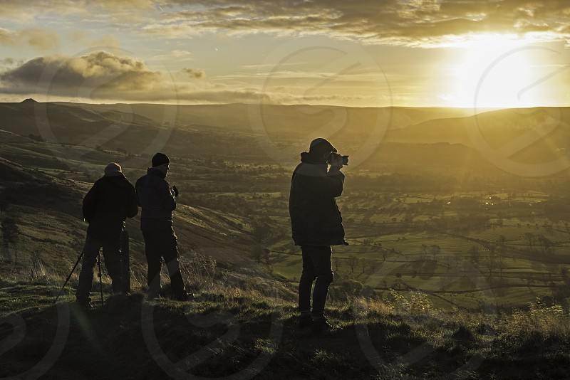 Photographers catching the sunrise on the Great Ridge over looking The Hope ValleyDerbyshire. photo