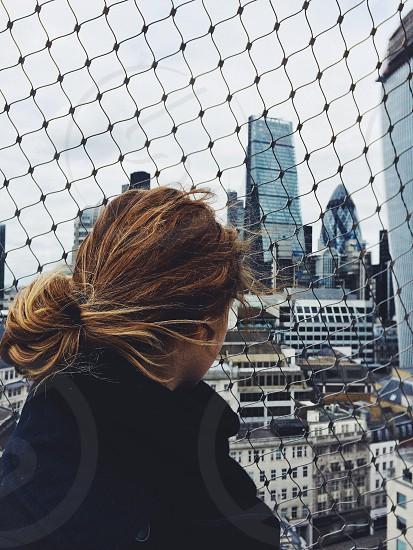 Woman watching the London skyline.  photo