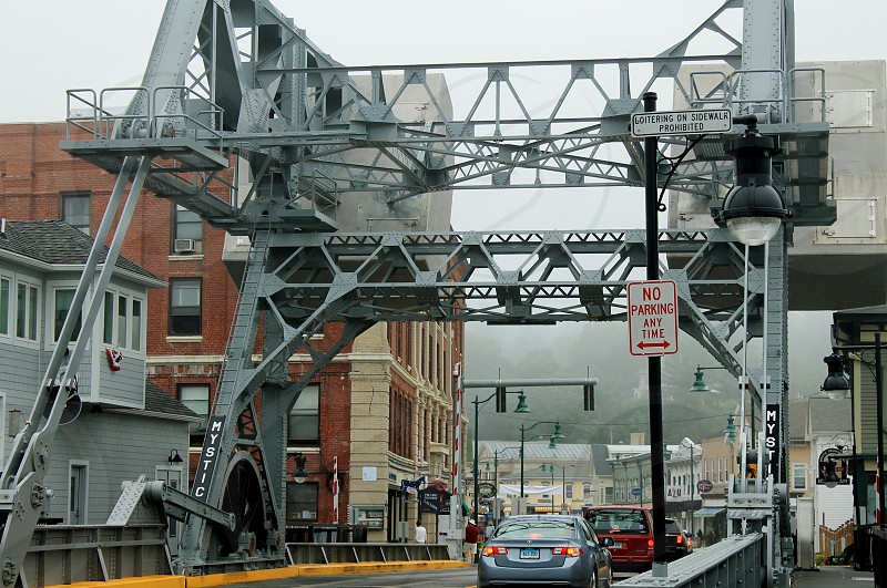 cars passing on gray steel folding bridge photo