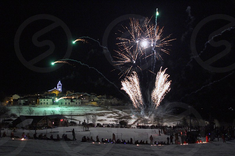 Fireworks seen from the ski slopes in a small village in Souther France. photo