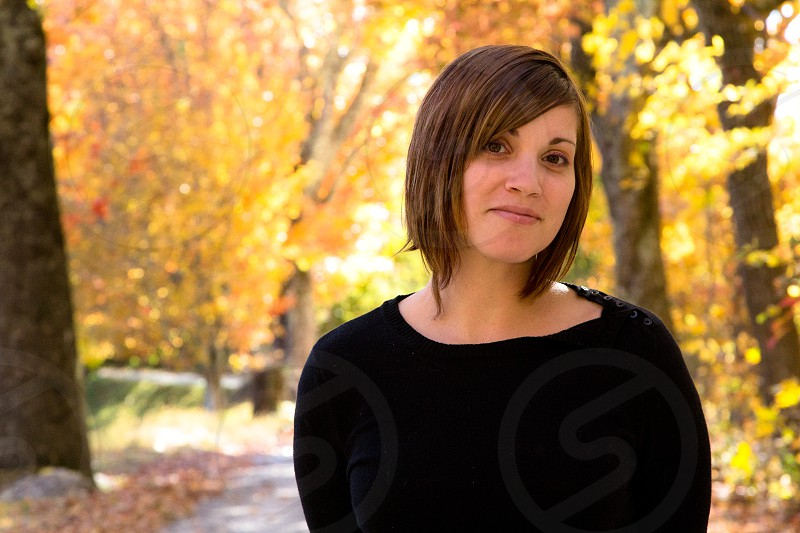 portrait female outdoors fall color dark brown photo