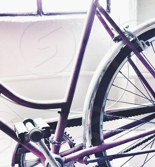 purple and black bicycle photo