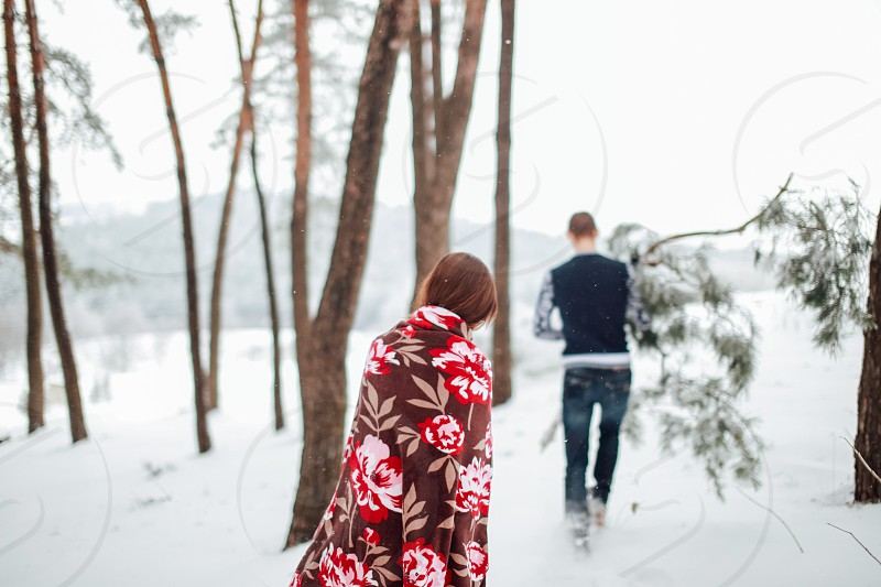 winter couple show love girl boy trees forest photo
