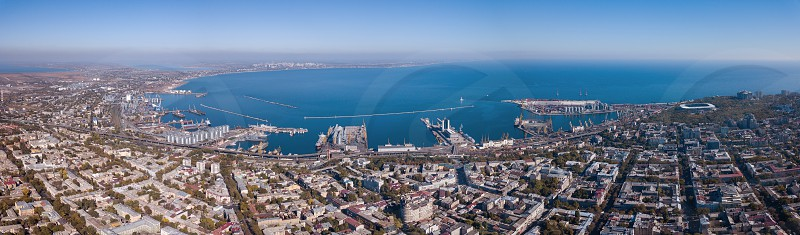 View of the Black Sea with the port and part of the city of Odessa against the blue sky on a summer day. Aerial view from the drone photo