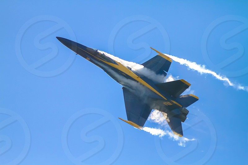 Fighter Jet with Contrails photo