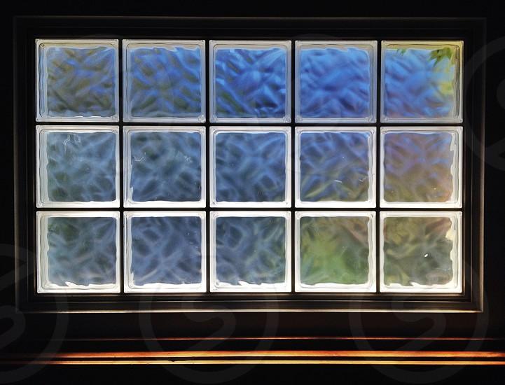 black framed glass window photo