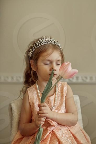 Little girl princess portrait with tulip flower photo