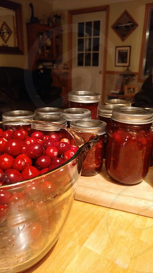 chores cranberries canning homemade mason jars clean up complete healthy fresh red bowl cranberry sauce portrait view photo