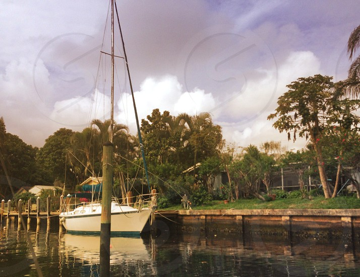 sail boat in water at dock photo