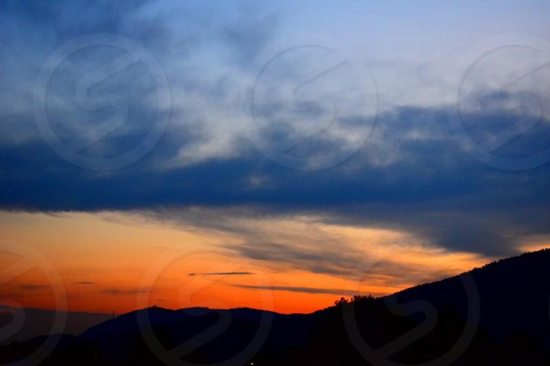 sunset nature mountain blue orange sky clouds landscape nightfall evening darkening photo