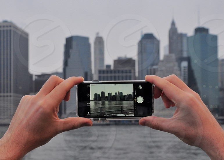 black iphone 6 showing city buildings on screen photo