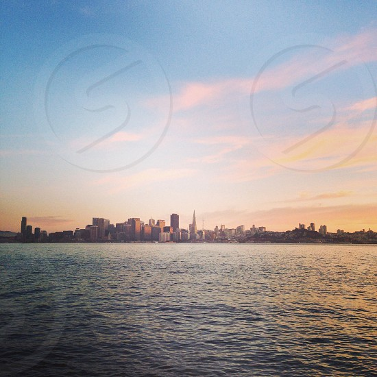 view of city buildings across the sea photo