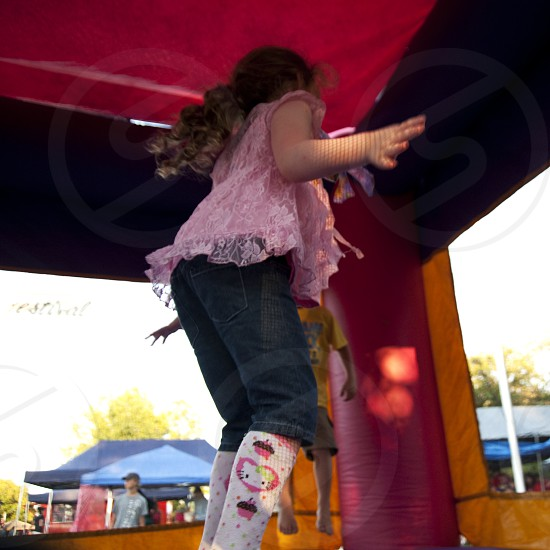 Girl jumping in bouncy house photo