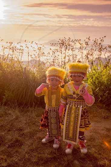childern of the Hill Tribe of Hmong enjoy at the Cliff of Phu Chi Fa in the Chiang Rai Province in North Thailand. photo