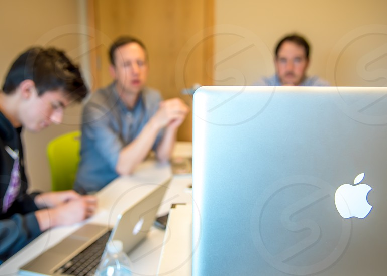 Group of males having a meeting in a technology company. photo