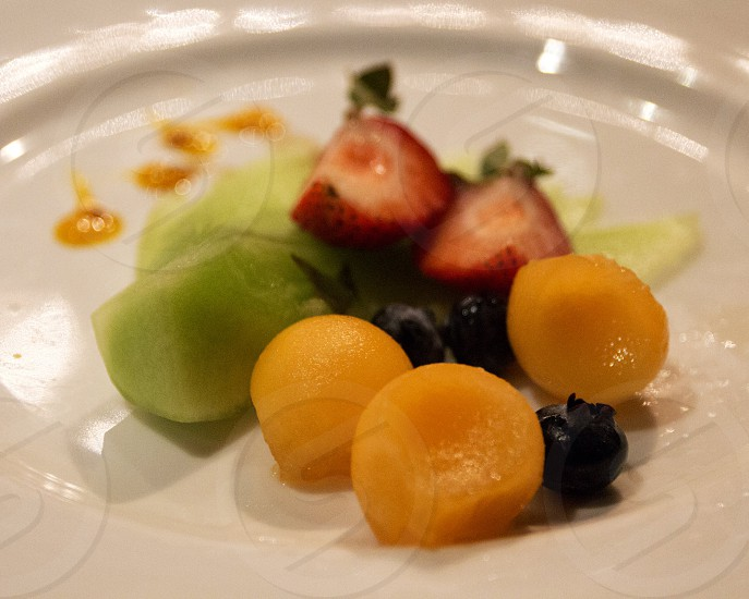Fruit plate with melon and berries photo