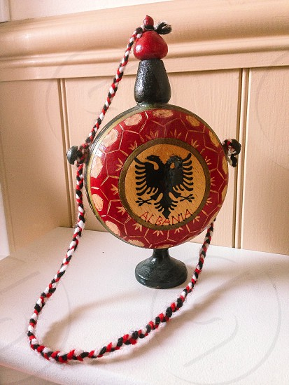 Cultural souvenir Albania red and black carving carved wooden flask eagle folk art Shqiperi  photo