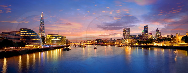 London skyline sunset with City Hall and financial on Thames river photo