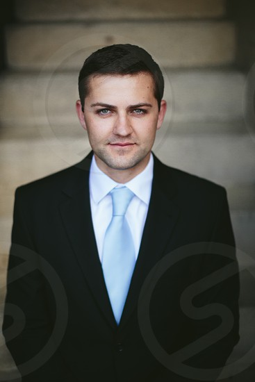man in black suit photo