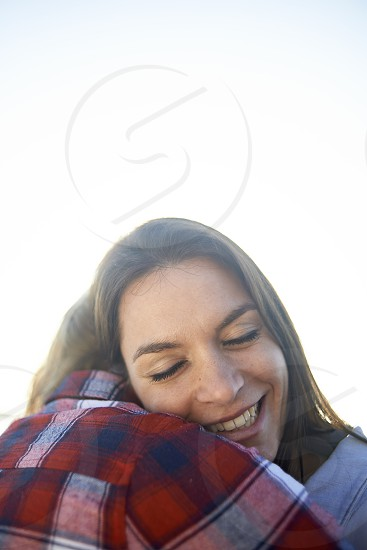 Cute young lesbian couple in a sweet embrace comforting each other photo