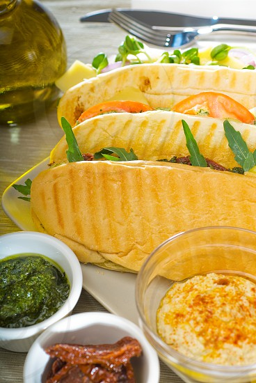 assortment of fresh homemade vegetarian  italian panini sandwichtypical italian snack photo