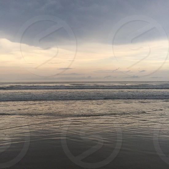 ocean water under gray sky photo